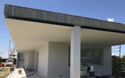 Aislamiento térmico de fachada en construcción modernista